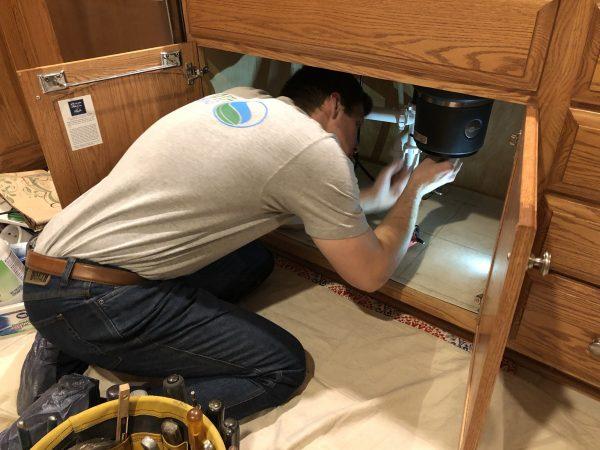 Craig Smith hard at work repairing a garbage disposal