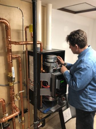 Dan Smith servicing a boiler Pierre SD